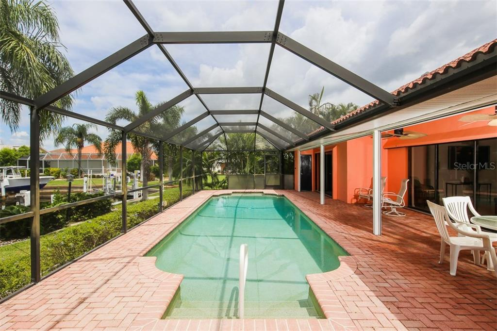 Swim laps in this spacious pool with brick pavers - Single Family Home for sale at 1620 Appian Dr, Punta Gorda, FL 33950 - MLS Number is C7242315