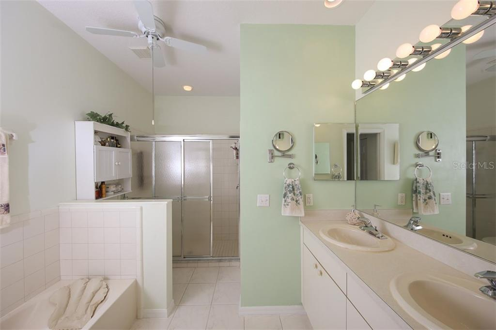 Master bedroom with dual sink vanity, garden tub and walk-in shower.  RELAX! - Villa for sale at 1234 Green Oak Trl, Port Charlotte, FL 33948 - MLS Number is C7243720