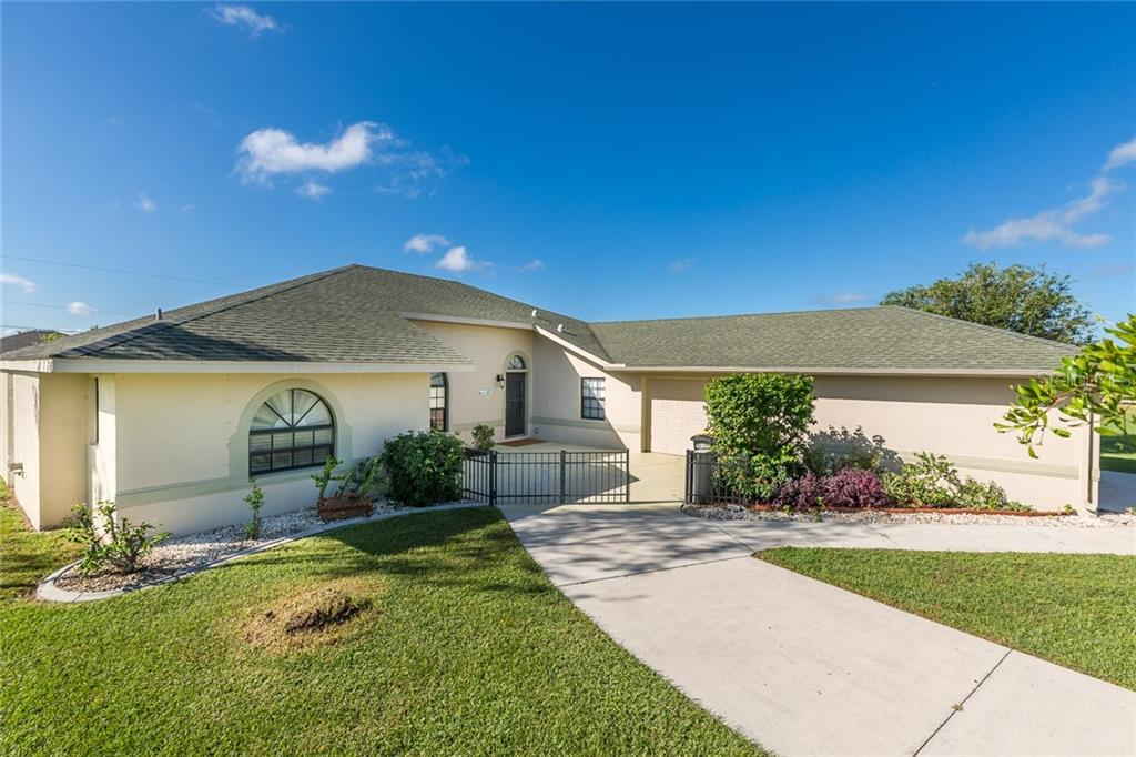Rear, Southeastern view of home, mature landscaping and fenced yard - Single Family Home for sale at 515 Royal Poinciana Cir, Punta Gorda, FL 33955 - MLS Number is C7244338