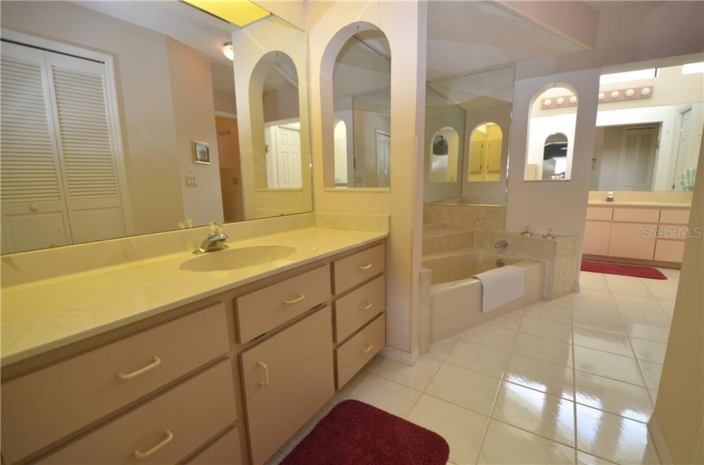 Exceptionally large master bath with dual sinks, garden tub, walk-in shower and walk-in closet - Single Family Home for sale at 2601 Parisian Ct, Punta Gorda, FL 33950 - MLS Number is C7244389