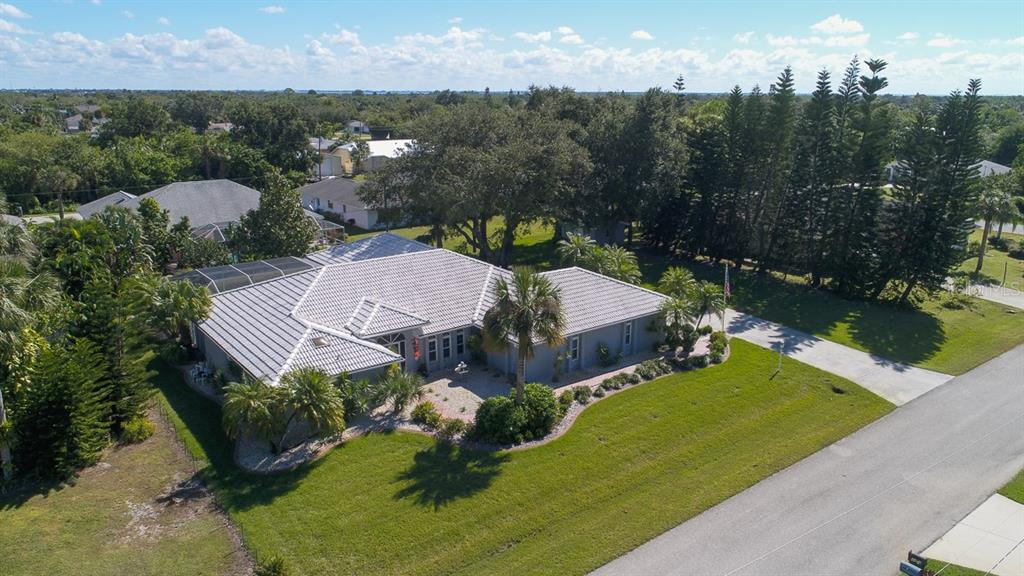Stunning home on almost half acre with side-loading oversized garage - Single Family Home for sale at 4407 Albacore Cir, Port Charlotte, FL 33948 - MLS Number is C7245070