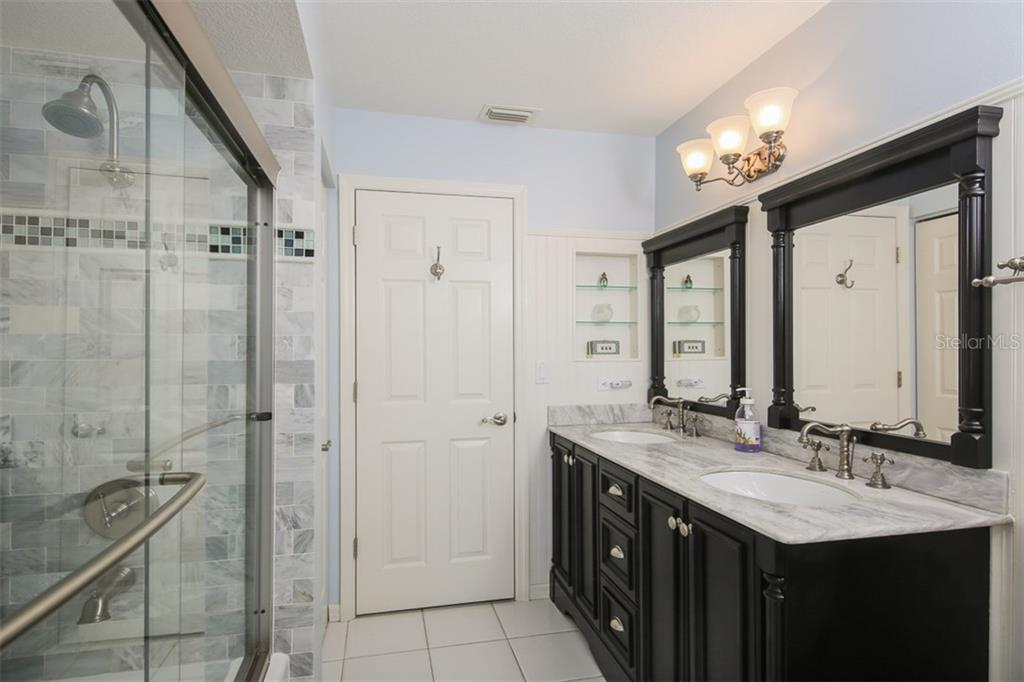 Remodeled guest bathroom includes wood cabinet & granite dual sink vanity with lovely shower/tub combination - Single Family Home for sale at 4407 Albacore Cir, Port Charlotte, FL 33948 - MLS Number is C7245070