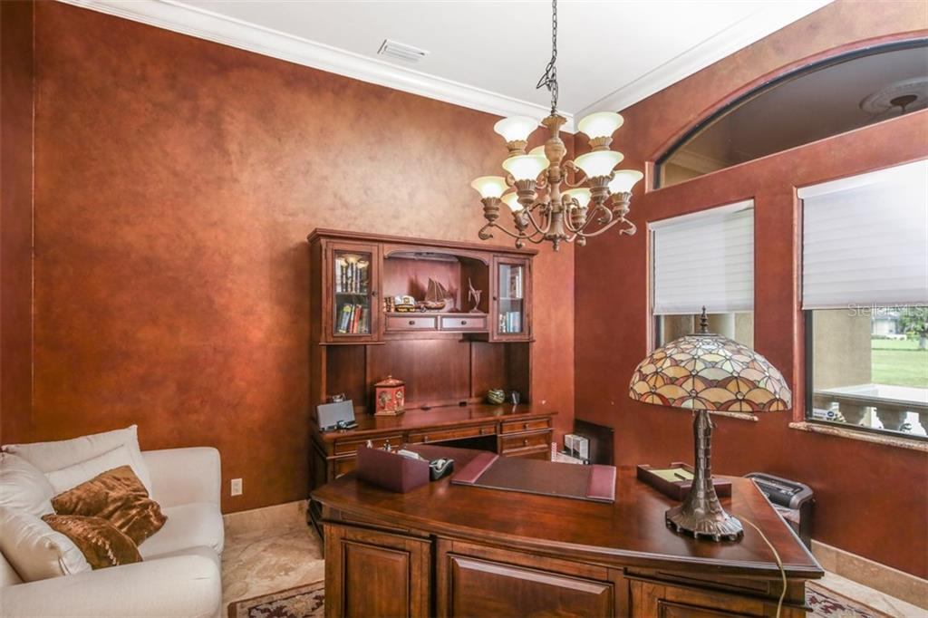 To the right of the double entry doors is this handsome office/formal dining room that overlooks the front verandah and manicured grounds. - Single Family Home for sale at 17208 Barcrest Ln, Punta Gorda, FL 33955 - MLS Number is C7245458