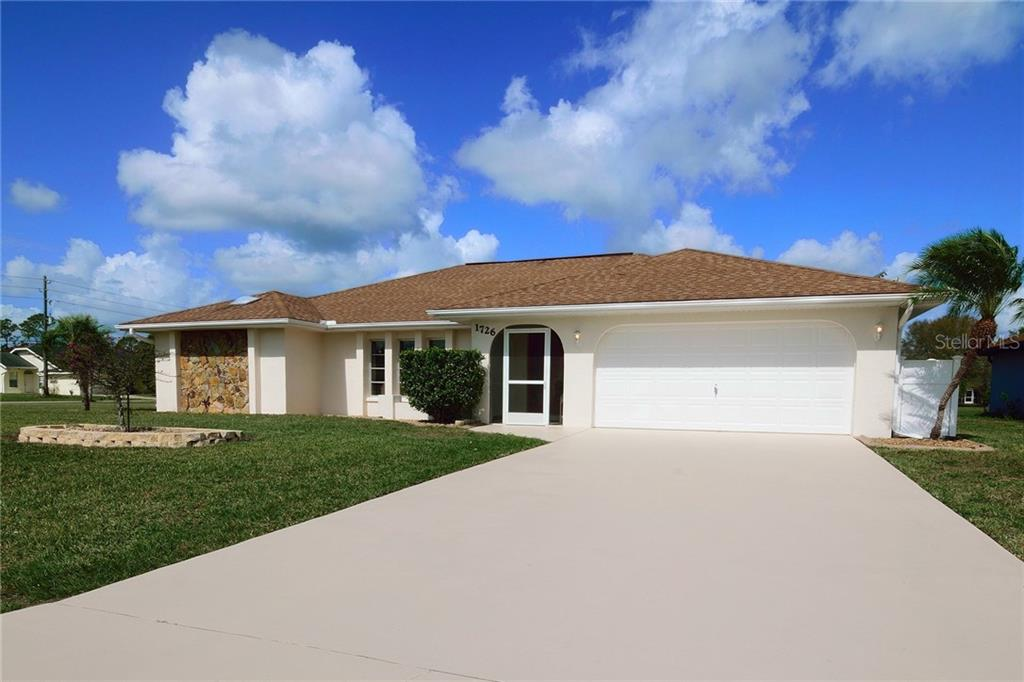 Single Family Home for sale at 1726 Blue Lake Cir, Punta Gorda, FL 33983 - MLS Number is C7249772