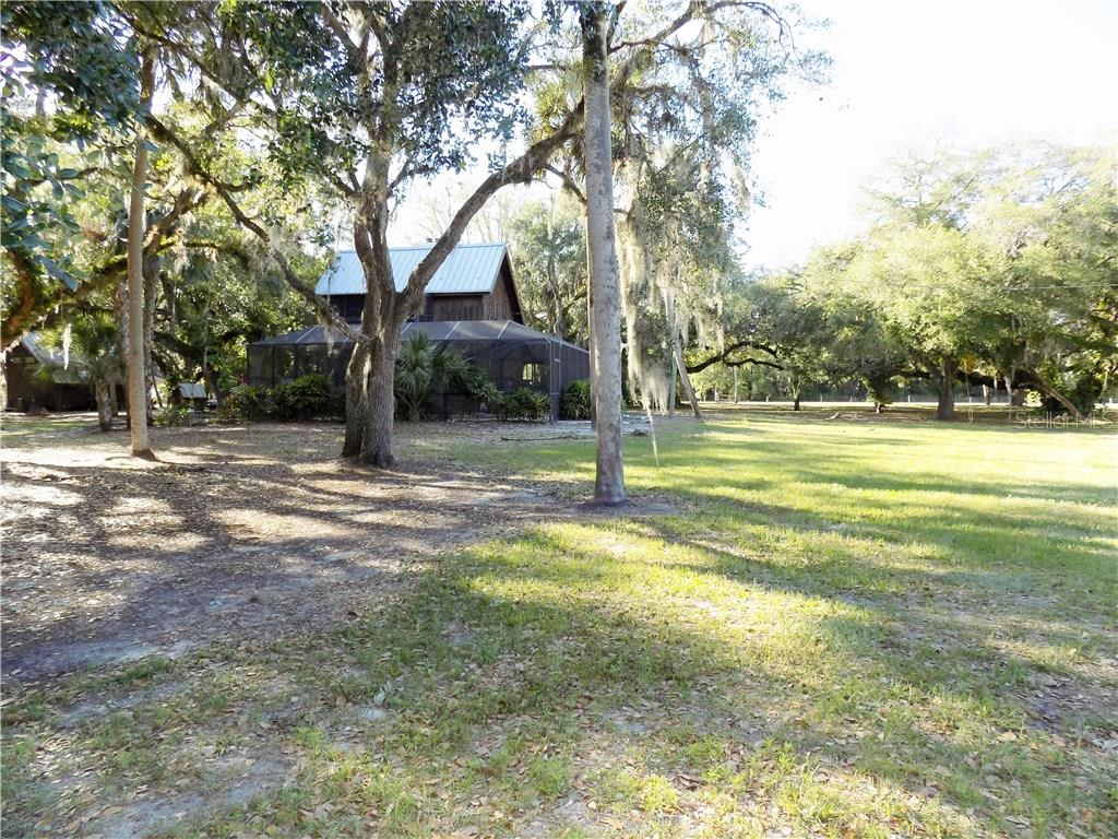 South Corner looking at the back of main house - Single Family Home for sale at 5624 Reisterstown Rd, North Port, FL 34291 - MLS Number is C7250923