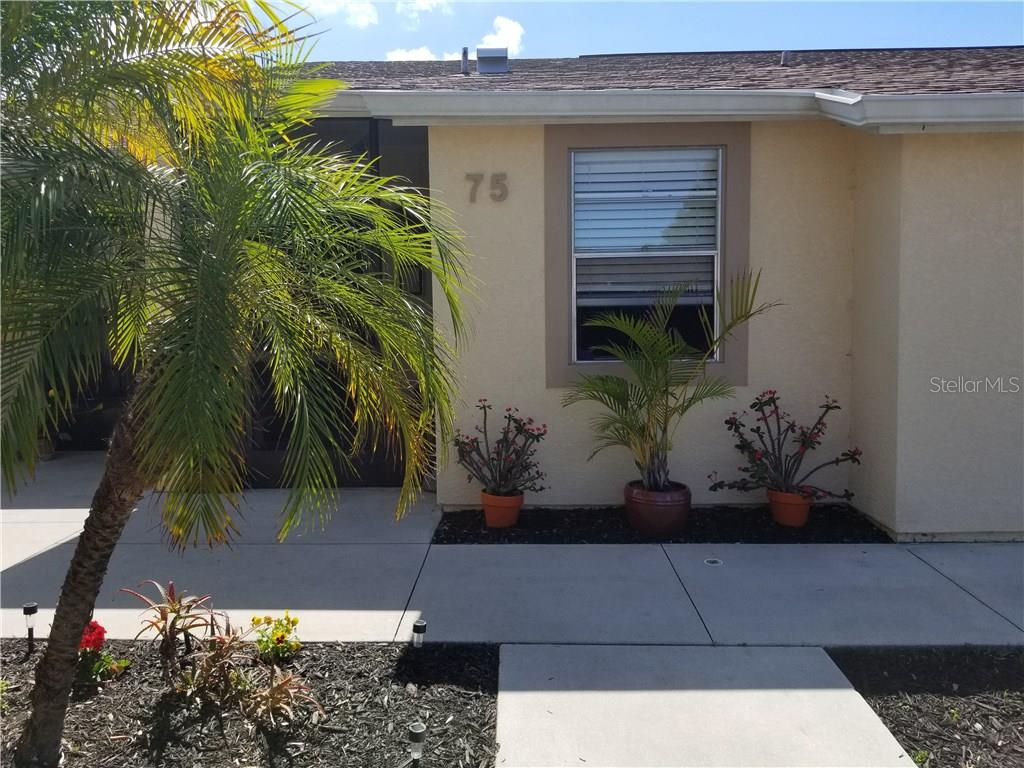 Front of Condo - Condo for sale at 6796 Gasparilla Pines Blvd #75, Englewood, FL 34224 - MLS Number is C7251454
