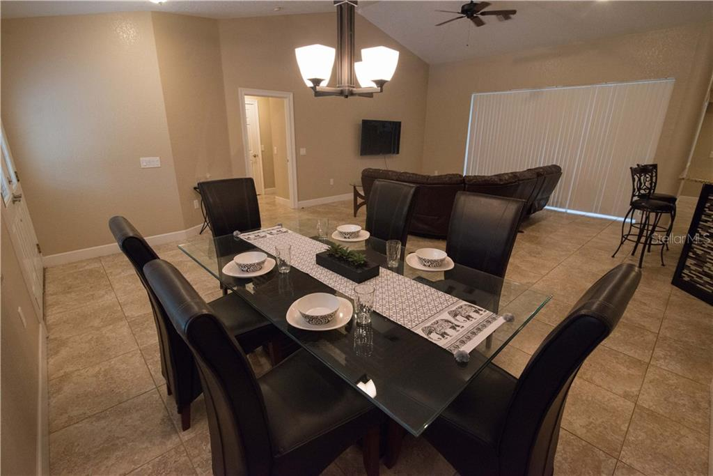This cozy breakfast nook area features French door access to the lanai and pool.  Open up the doors and let the sunshine and fresh country air in! - Single Family Home for sale at 3184 Ulman Ave, North Port, FL 34286 - MLS Number is C7400587