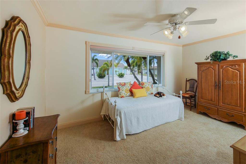 Guest bedroom has crown molding - Single Family Home for sale at 158 Morgan Ln Se, Port Charlotte, FL 33952 - MLS Number is C7400633