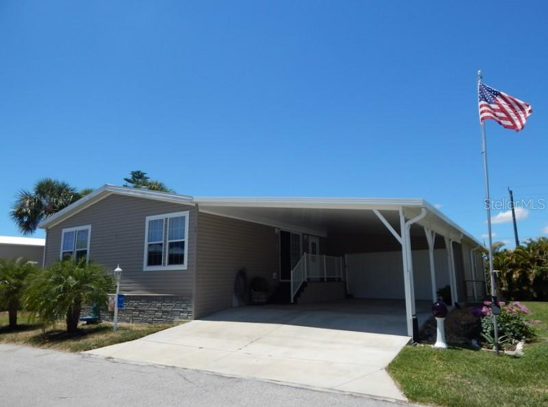 Nice curb appeal and wide driveway. - Manufactured Home for sale at 11 Holland Ave, Punta Gorda, FL 33950 - MLS Number is C7401035