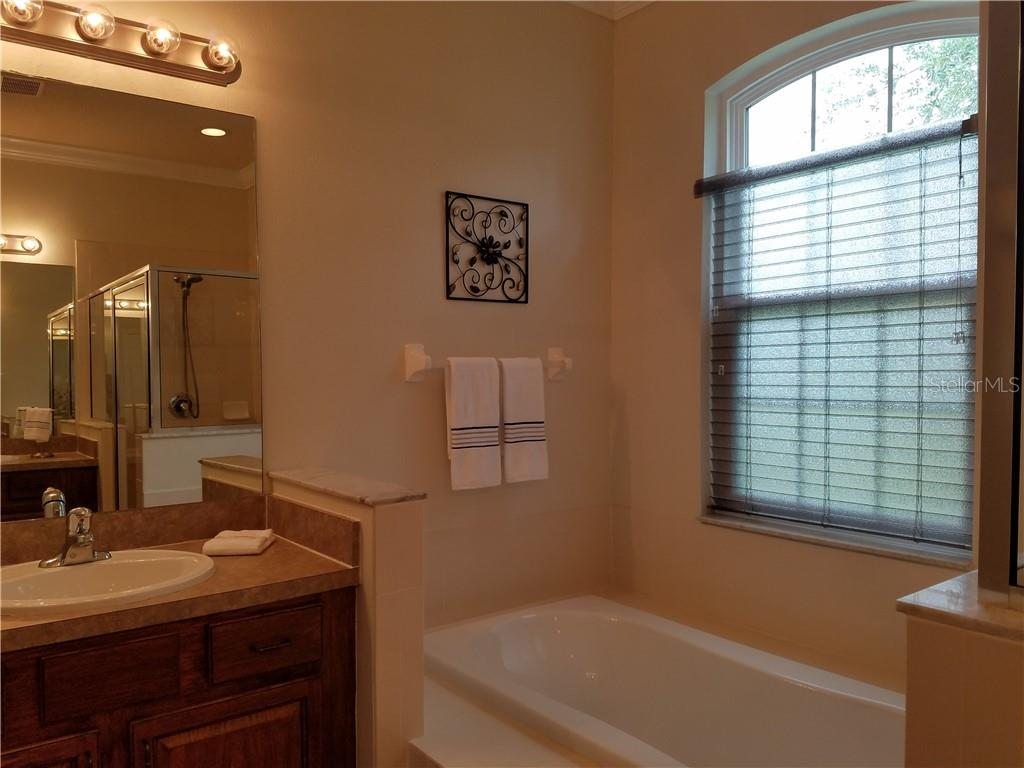 A large shower, a tub and a linnen closet round off the features in this bright room. - Single Family Home for sale at 2752 Suncoast Lakes Blvd, Punta Gorda, FL 33980 - MLS Number is C7402671