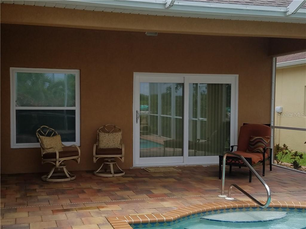 The covered portion is the perfect spot when some shade is desired. - Single Family Home for sale at 2752 Suncoast Lakes Blvd, Punta Gorda, FL 33980 - MLS Number is C7402671