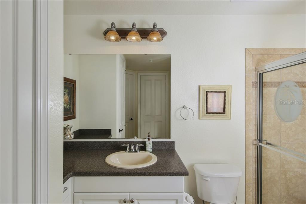 Guest bathroom with walk-in shower - Condo for sale at 95 Vivante Blvd #303, Punta Gorda, FL 33950 - MLS Number is C7402746