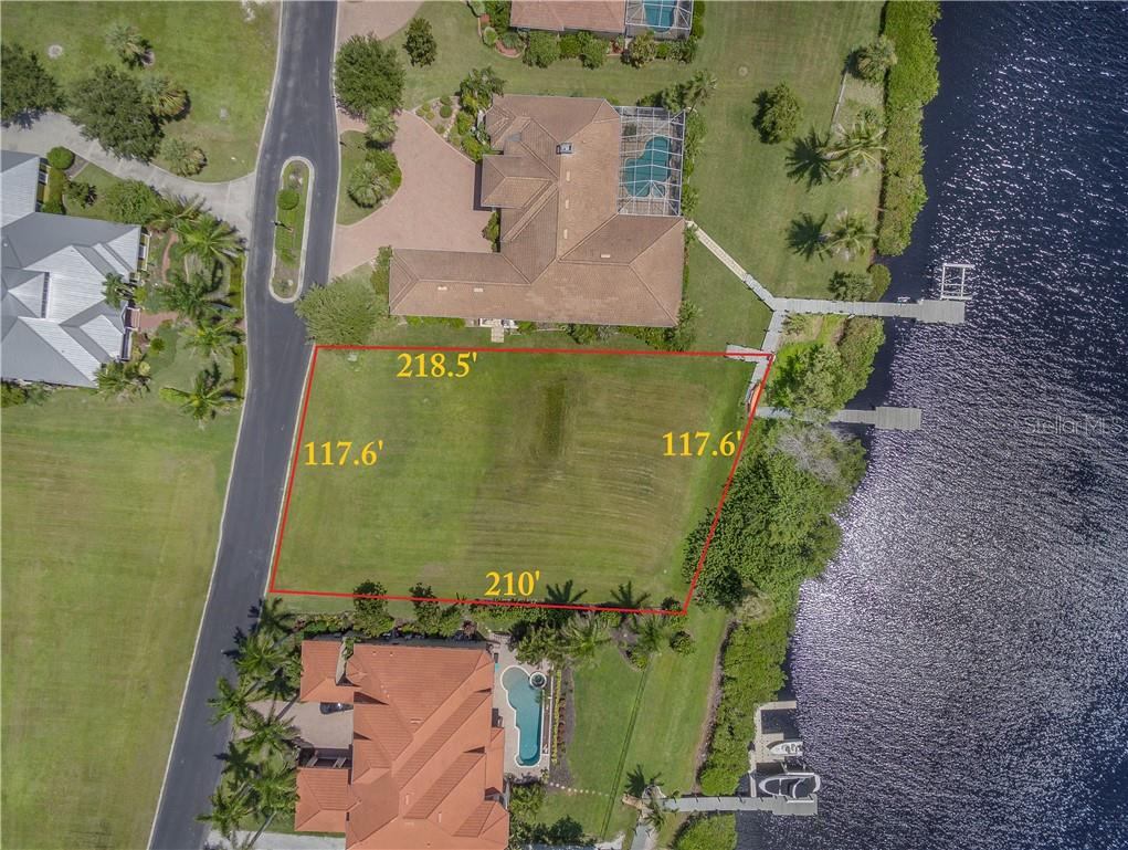Overhead Drone picture of the vacant parcel #4 inside the private, gated subdivision of Lea Marie Island, showing East Spring Waterway that leads to Charlotte Harbor. Charlotte Harbor is know as a world class fishing destination and is the 2nd largest freshwater fed Harbor in the State of Florida, Tampa Bay is the largest. - Vacant Land for sale at 4030 Lea Marie Island Dr, Port Charlotte, FL 33952 - MLS Number is C7404124