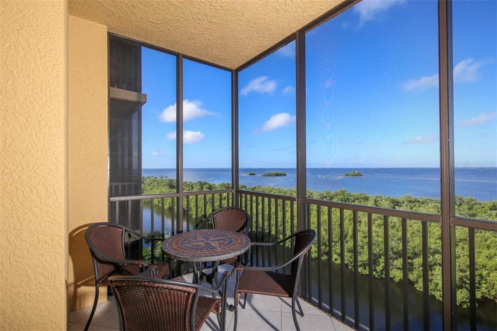 The left end of the lanai offers views toward the entrance channel of Burnt Store Marina. - Condo for sale at 3329 Sunset Key Cir #503, Punta Gorda, FL 33955 - MLS Number is C7406727