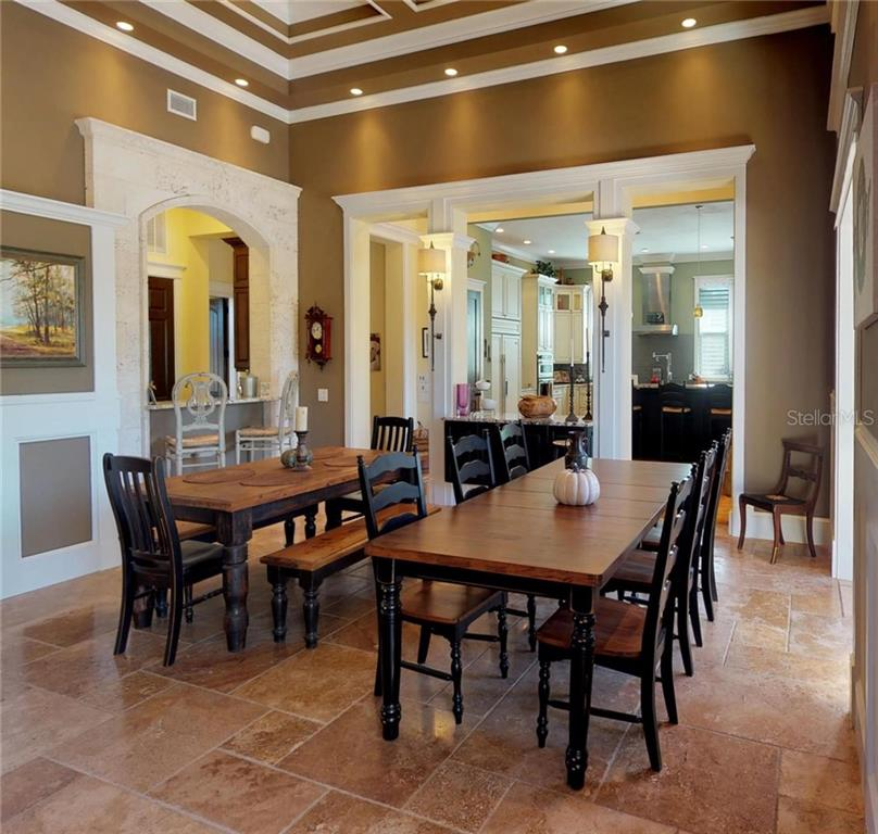 Dining area and a separate bar area to the left also surrounded with Custom Cut Coral Shell Stone. - Single Family Home for sale at 1289 Casper St, Port Charlotte, FL 33953 - MLS Number is C7407177