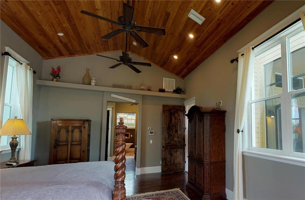 Master Bedroom is beautiful with Pecky Cypress Wood Ceilings and Bruce Distressed Wood Floors. - Single Family Home for sale at 1289 Casper St, Port Charlotte, FL 33953 - MLS Number is C7407177