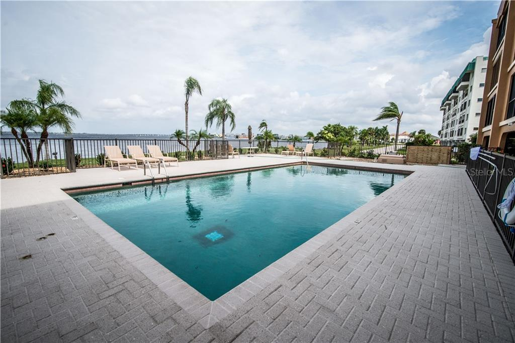 Enjoy the Harbor-front outdoor heated pool.  This is an incredible setting for watching the night sunset skies and the twinkling lights over Fisherman's Village and Punta Gorda! - Condo for sale at 1601 Park Beach Cir #112 / 2, Punta Gorda, FL 33950 - MLS Number is C7407435