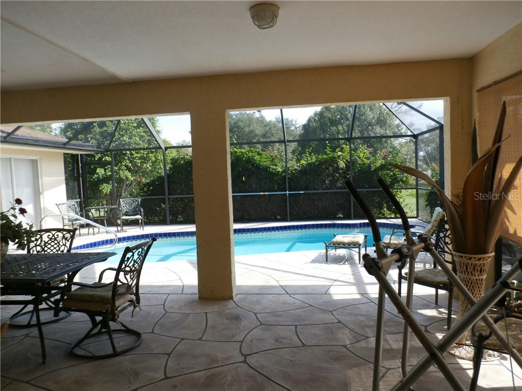 Pool and lanai view - Single Family Home for sale at 416 Bahia Grande Ave, Punta Gorda, FL 33983 - MLS Number is C7408301