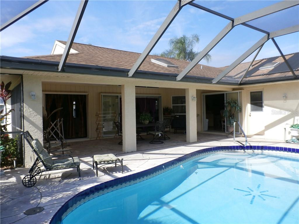 Caged pool and lanai - Single Family Home for sale at 416 Bahia Grande Ave, Punta Gorda, FL 33983 - MLS Number is C7408301