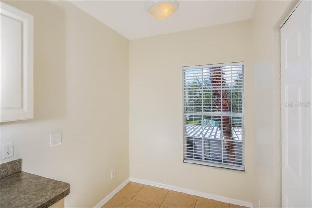 Dinette area in Kitchen with window & pantry closet - Condo for sale at 2040 Willow Hammock Cir #b208, Punta Gorda, FL 33983 - MLS Number is C7408424