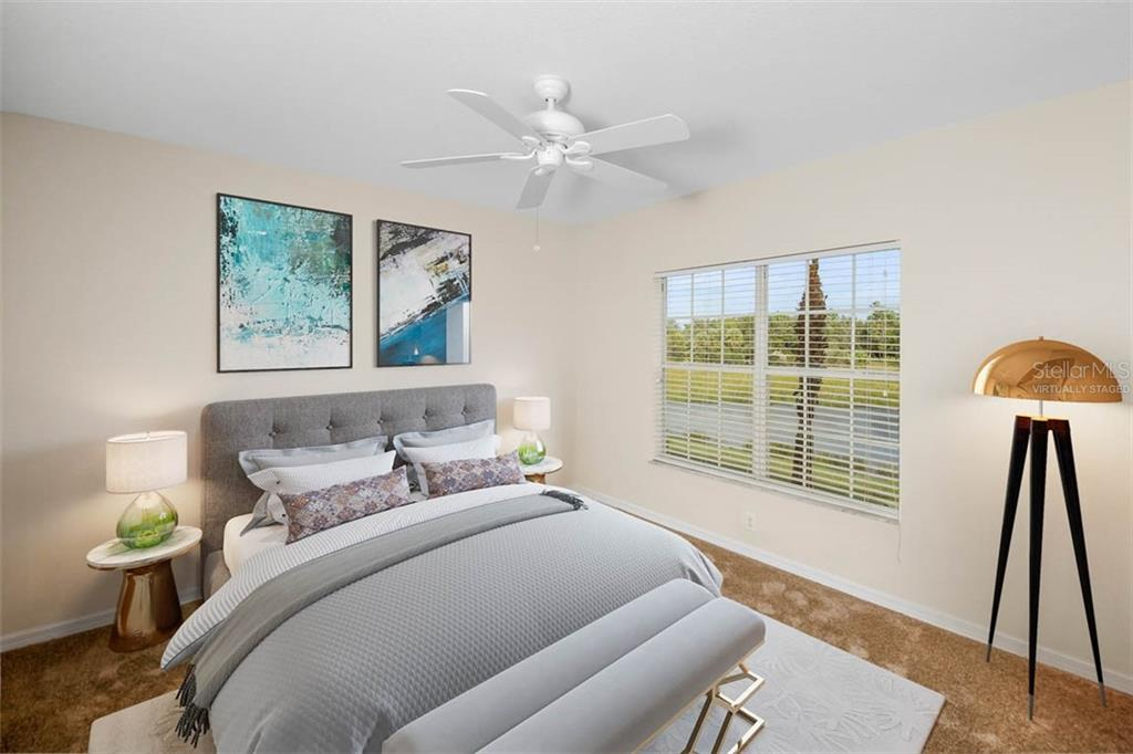 Virtually staged Master Bedroom has peaceful lake views. - Condo for sale at 2040 Willow Hammock Cir #b208, Punta Gorda, FL 33983 - MLS Number is C7408424
