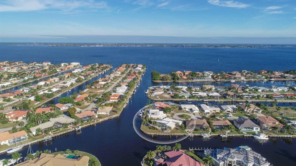 Large basin of intersecting canals clustered with showcase homes - Single Family Home for sale at 2291 Bayview Rd, Punta Gorda, FL 33950 - MLS Number is C7409445