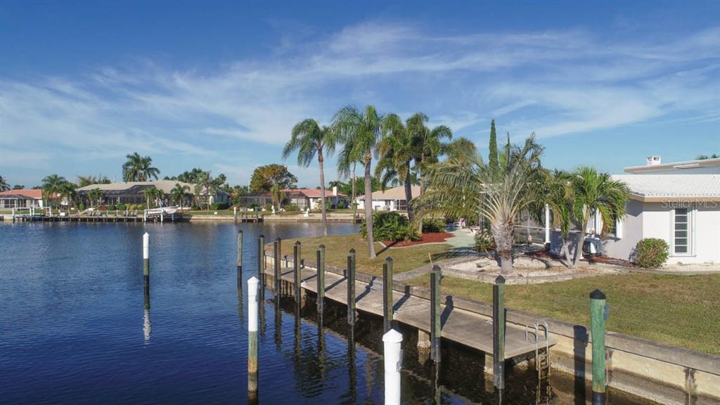 Large dock with out piling ready for your yacht, just off the Owner's wing. - Single Family Home for sale at 2291 Bayview Rd, Punta Gorda, FL 33950 - MLS Number is C7409445