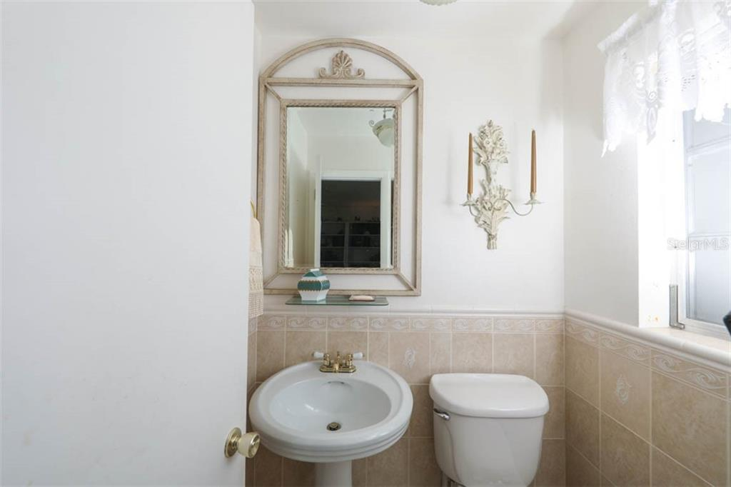 Tiled half bath with window. - Single Family Home for sale at 2291 Bayview Rd, Punta Gorda, FL 33950 - MLS Number is C7409445