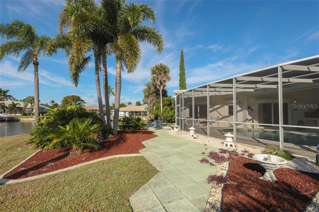 Rear patio off pool cage. - Single Family Home for sale at 2291 Bayview Rd, Punta Gorda, FL 33950 - MLS Number is C7409445
