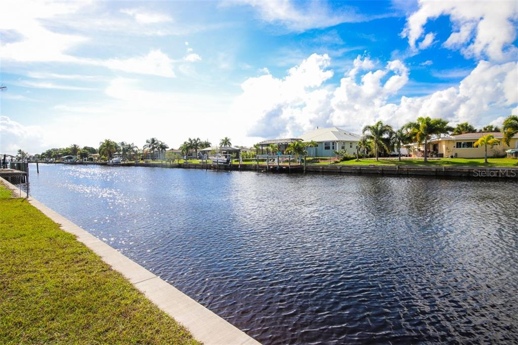 Canal looking southwest toward Harbor - Single Family Home for sale at 126 Bangsberg Rd Se, Port Charlotte, FL 33952 - MLS Number is C7409866