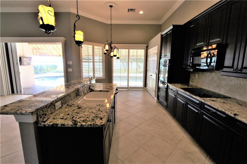 Kitchen - Single Family Home for sale at 2823 Mill Creek Rd, Port Charlotte, FL 33953 - MLS Number is C7409892