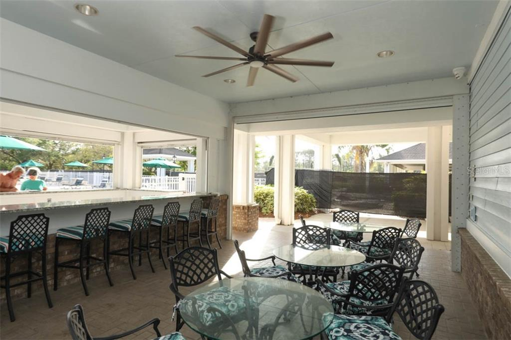 Outdoor bar and covered lanai at clubhouse - Condo for sale at 4643 Club Dr #102, Port Charlotte, FL 33953 - MLS Number is C7413207