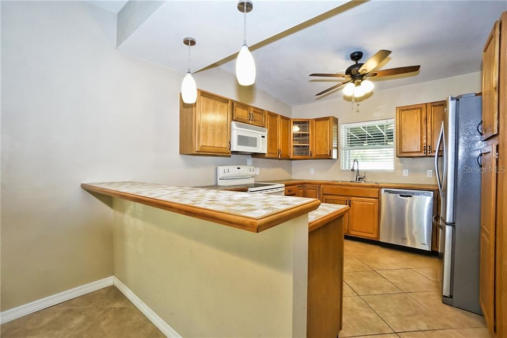 Kitchen - Single Family Home for sale at 3513 Areca St, Punta Gorda, FL 33950 - MLS Number is C7414620