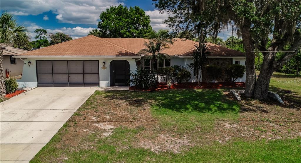 Single Family Home for sale at 1484 Abscott St, Port Charlotte, FL 33952 - MLS Number is C7414670