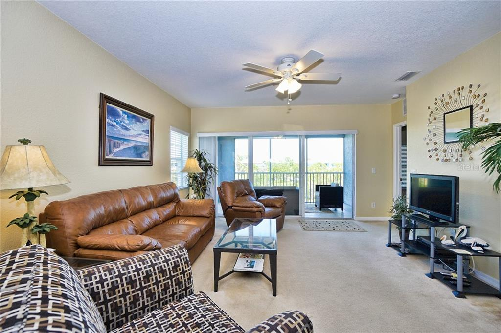 Great room looking out to lanai - Condo for sale at 8405 Placida Rd #401, Placida, FL 33946 - MLS Number is C7414726