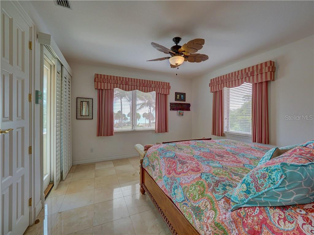Separate guest room suite features kitchenette, living area, two bedrooms, and two bathrooms. - Single Family Home for sale at 6150 Manasota Key Rd, Englewood, FL 34223 - MLS Number is C7415176