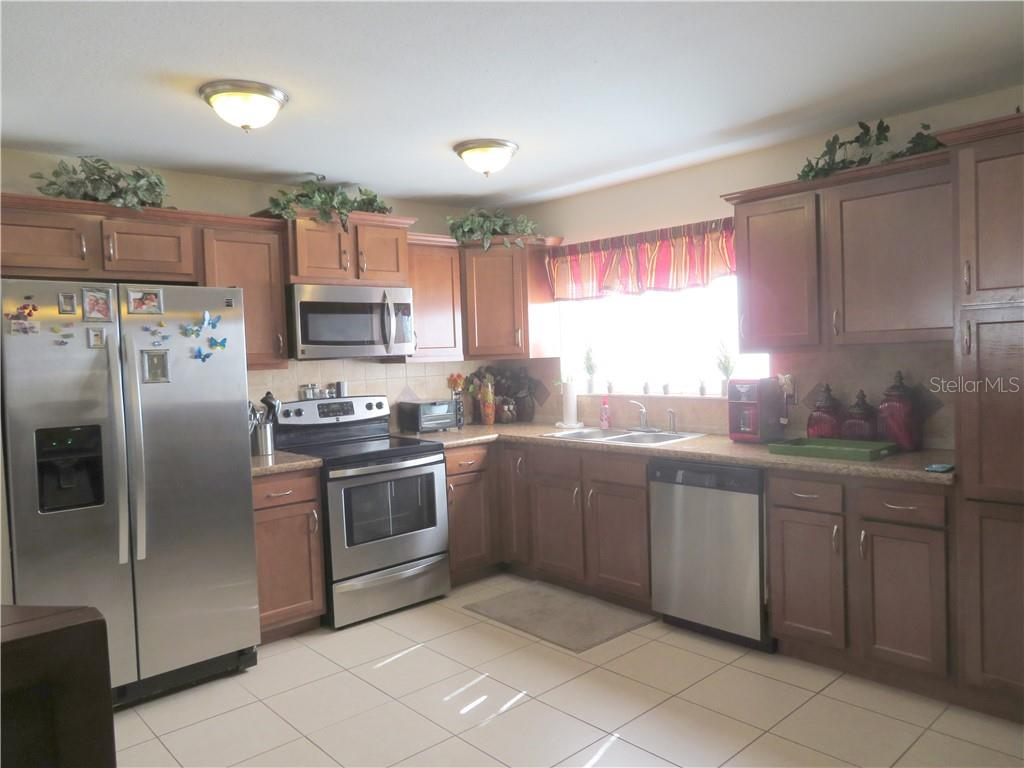 Updated kitchen, crowned cabinets, tile floors - Single Family Home for sale at 4275 Tollefson Ave, North Port, FL 34287 - MLS Number is C7416188