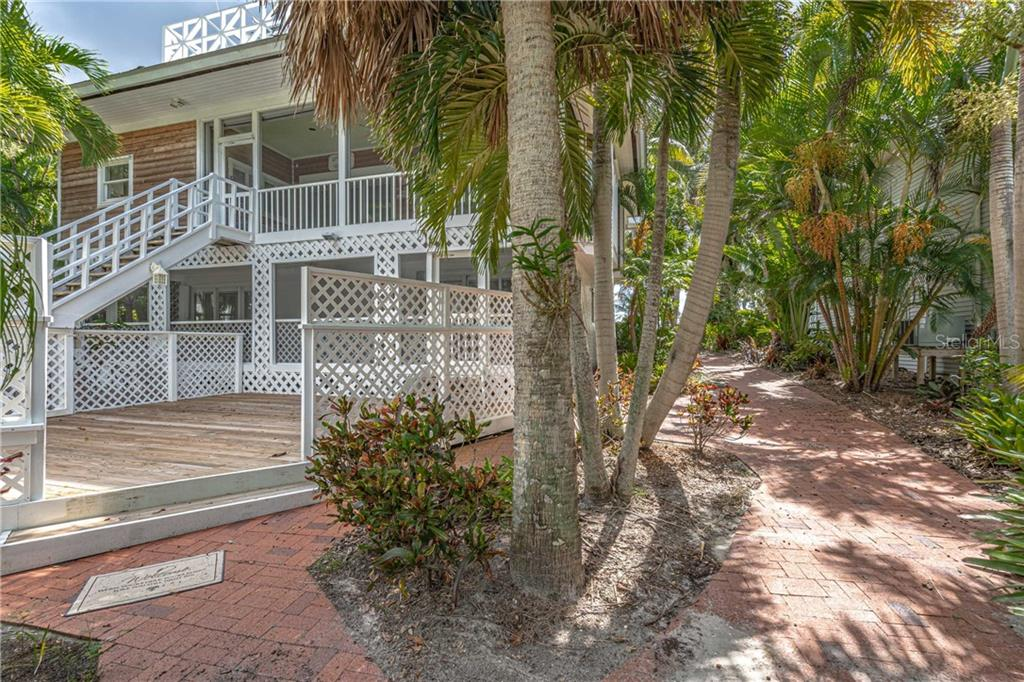 view from the rear pathway - Single Family Home for sale at 124 Useppa Is, Captiva, FL 33924 - MLS Number is C7419408