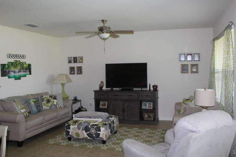 Living Room - Single Family Home for sale at 25000 Lalique Pl, Punta Gorda, FL 33950 - MLS Number is C7421067