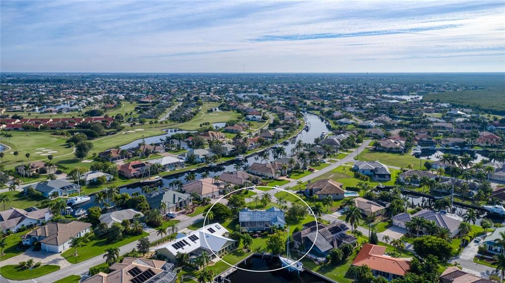 Aerial of the home from the back - this is truly a fabulous neighborhood - Single Family Home for sale at 5001 Captiva Ct, Punta Gorda, FL 33950 - MLS Number is C7422558