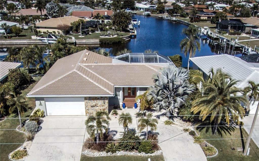 Welcome home to 1440 Appian where you will enjoy all that waterfront living has to offer in this three bedroom, two bath, two-car garage home. - Single Family Home for sale at 1440 Appian Dr, Punta Gorda, FL 33950 - MLS Number is C7425399