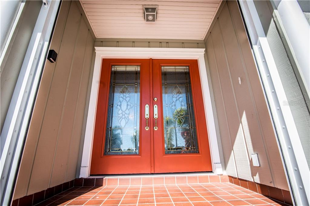 Stunning glass etched double doors welcome you from your circular drive.  Home features Xfinity security indication when doors are opened or closed. - Single Family Home for sale at 1440 Appian Dr, Punta Gorda, FL 33950 - MLS Number is C7425399
