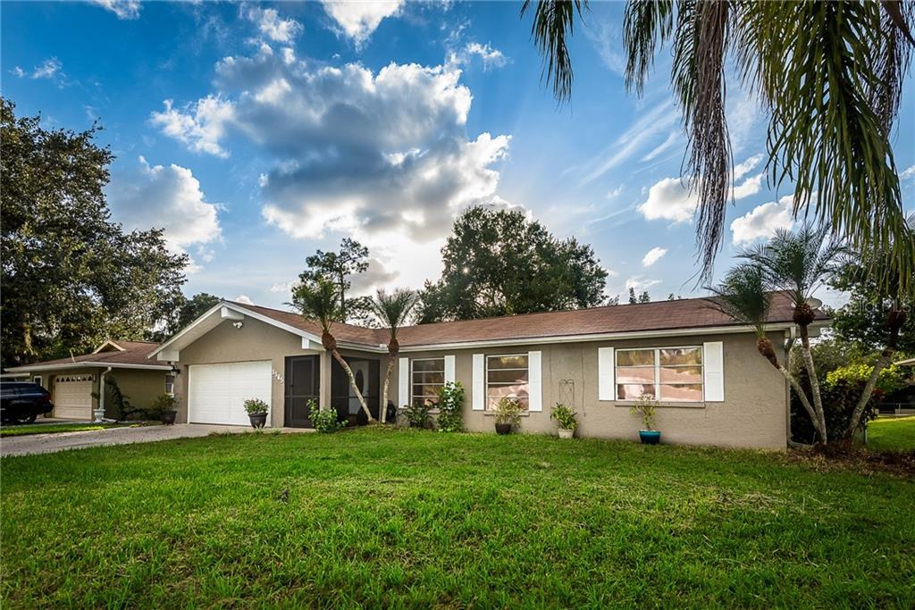 A FRONT VIEW OF THE HOME - Single Family Home for sale at 1365 Arrow St, Port Charlotte, FL 33952 - MLS Number is C7435304