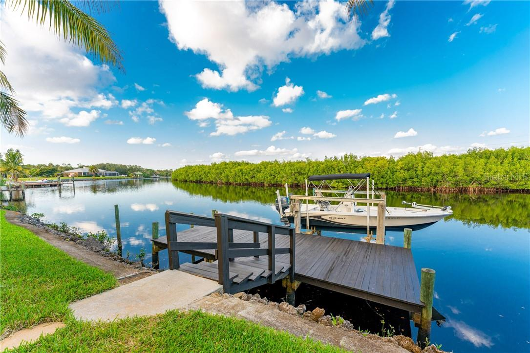At the water, your boat is ready for endless enjoyment at the boat dock and lift with concrete pilings - Single Family Home for sale at 7440 Riverside Dr, Punta Gorda, FL 33982 - MLS Number is C7436263