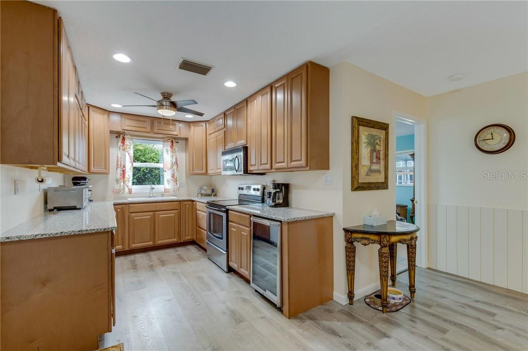 Brand new kitchen with cherry soft close wood cabinets, granite countertops, new appliances including a beverage cooler. - Single Family Home for sale at 24368 Blackbeard Blvd, Punta Gorda, FL 33955 - MLS Number is C7436898