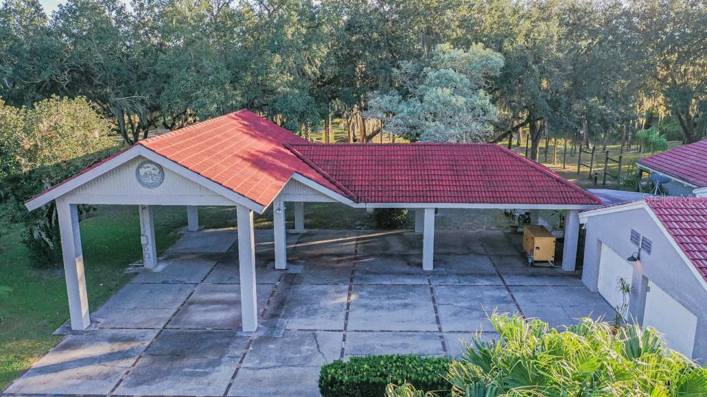 Attached 4 Car Carport/RV Carport - Main House - Single Family Home for sale at 1 Woodland Dr, Punta Gorda, FL 33982 - MLS Number is C7436906