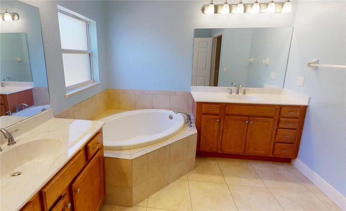 Master bath dual vanities and soaking tub. - Single Family Home for sale at 11905 Florence Ave, Port Charlotte, FL 33981 - MLS Number is C7441003
