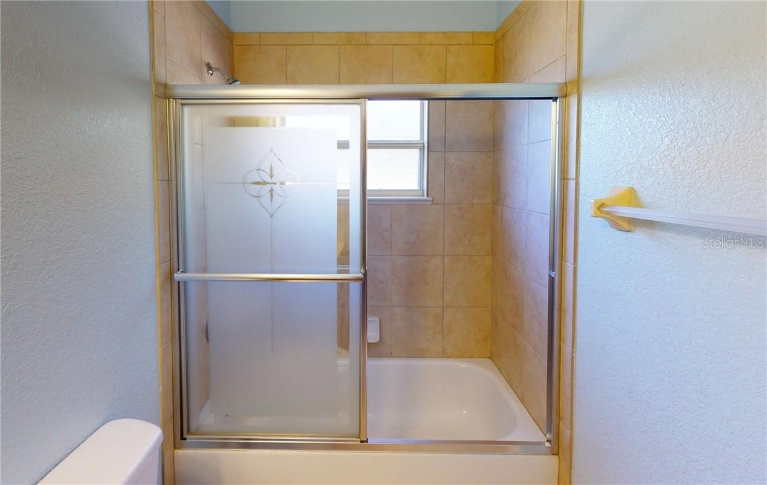 Guest bath tub shower combo. - Single Family Home for sale at 11905 Florence Ave, Port Charlotte, FL 33981 - MLS Number is C7441003