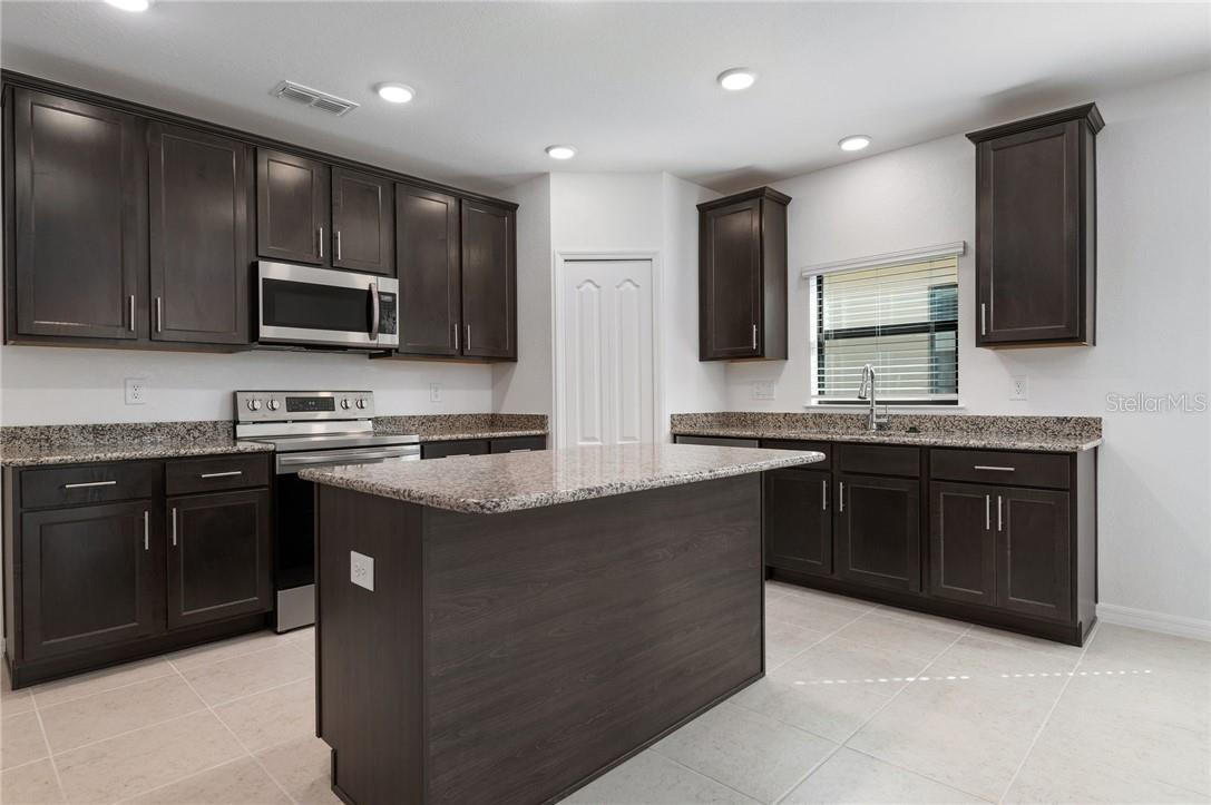 The kitchen accommodates more than one chef! - Single Family Home for sale at 2082 Apian Way, Port Charlotte, FL 33953 - MLS Number is C7441465