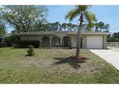 Front View - Single Family Home for sale at 2485 Cannolot Blvd, Port Charlotte, FL 33948 - MLS Number is C7239784